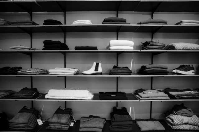 Grey scale image of clothing store shelves